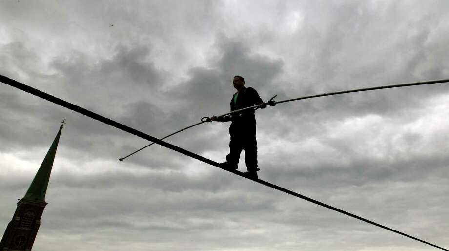 Nik Wallenda performs a walk on a tightrope in the rain during training for his walk over Niagara Falls in Niagara Falls, N.Y., Wednesday, May 16, 2012. Photo: David Duprey, AP / AP