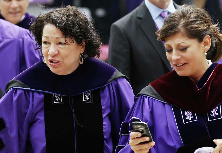 NEW YORK, NY - MAY 16:  U.S. Supreme Court Justice Sonia Sotomayor (L) and TV financial journalist Maria Bartiromo (R) depart New York University's commencement ceremony at Yankee Stadium on May 16, 2012 in the Bronx borough of New York City. Sotomayor spoke to a crowd of more than 27,000 at the ceremony and was raised in a Bronx housing project not far from the stadium. Photo: Mario Tama, Getty Images / 2012 Getty Images