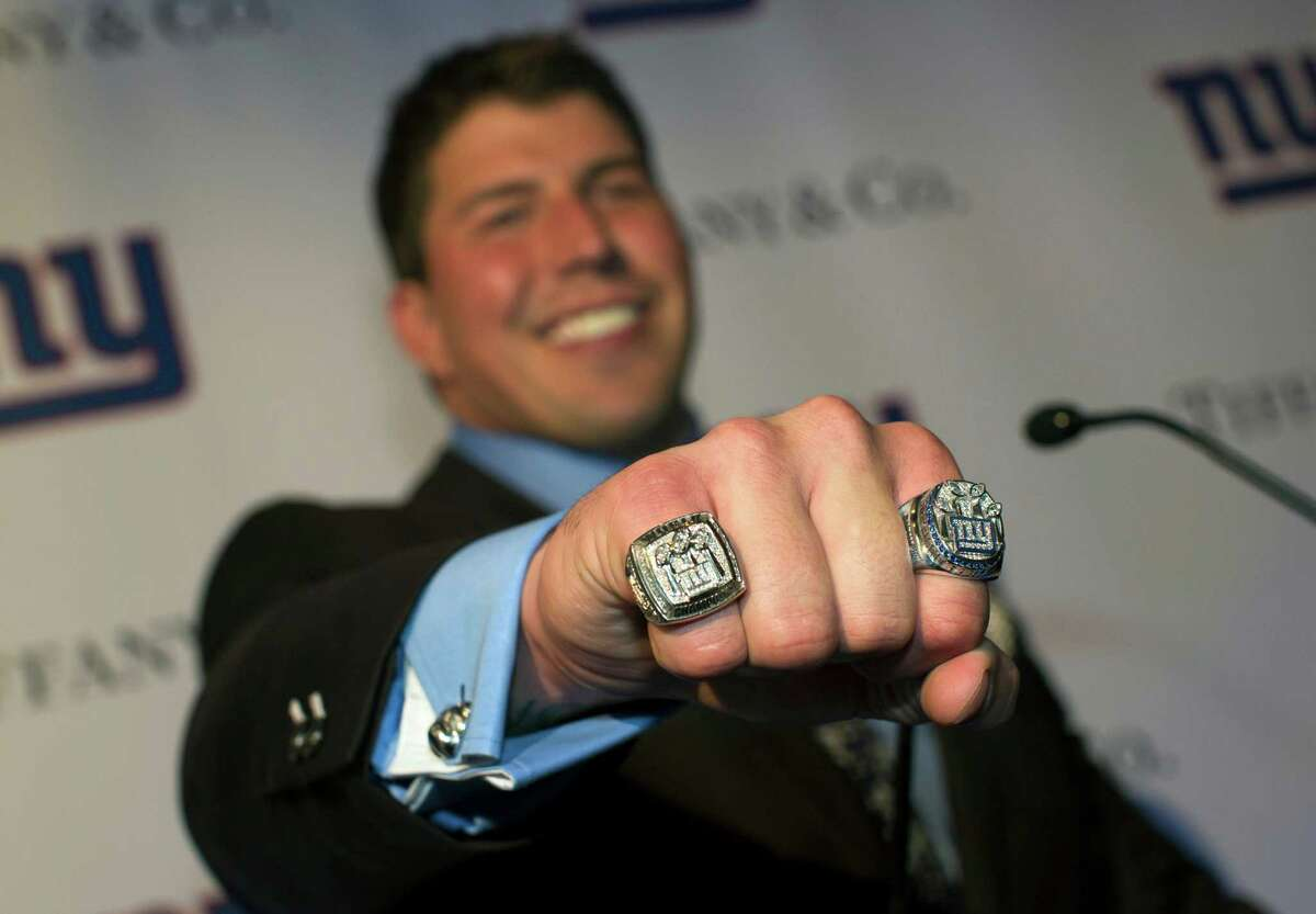 New York Giants offensive lineman David Diehl poses with his Super Bowl XLVI ring at Tiffany & Co., Wednesday, May 16, 2012, in New York. The Giants defeated the New England Patriots 21-17 in NFL football's Super Bowl XLVI to attain their fourth championship in franchise history.