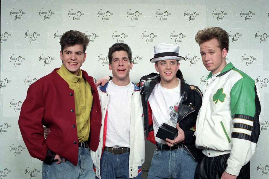 New Kids on the Block singer Jordan Knight, left, was about 20 years old when this uber-boy band took over the world. / AP1990