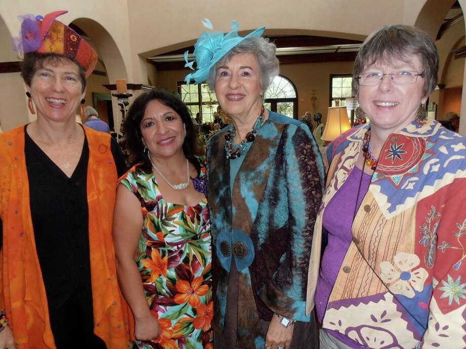 Fiber Artists of San Antonio members Dale Jenssen, from left, Maria Davis, Adrienne King and Becky Heye enjoy the group's annual fashion show and luncheon. Photo: Nancy Cook-Monroe, For The Express-News / Photo by Nancy Cook-Monroe