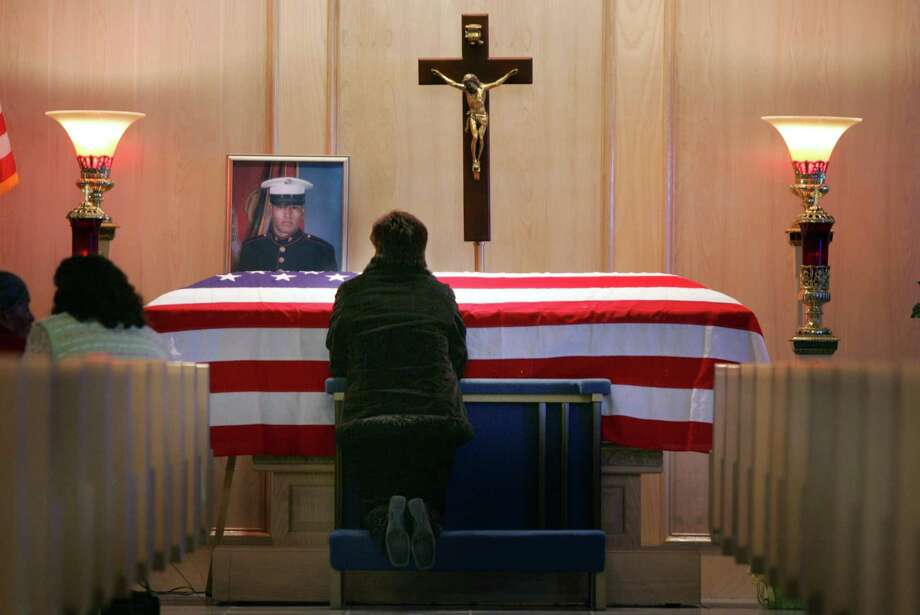 Senobia Alvarez grieves at the coffin of her son, U.S. Marine Lance Cpl. Julio C. Cisneros Alvarez, in San Juan in 2005. Grieving is painful but it's also private and precious. Photo: File Photo, Associated Press / THE MONITOR