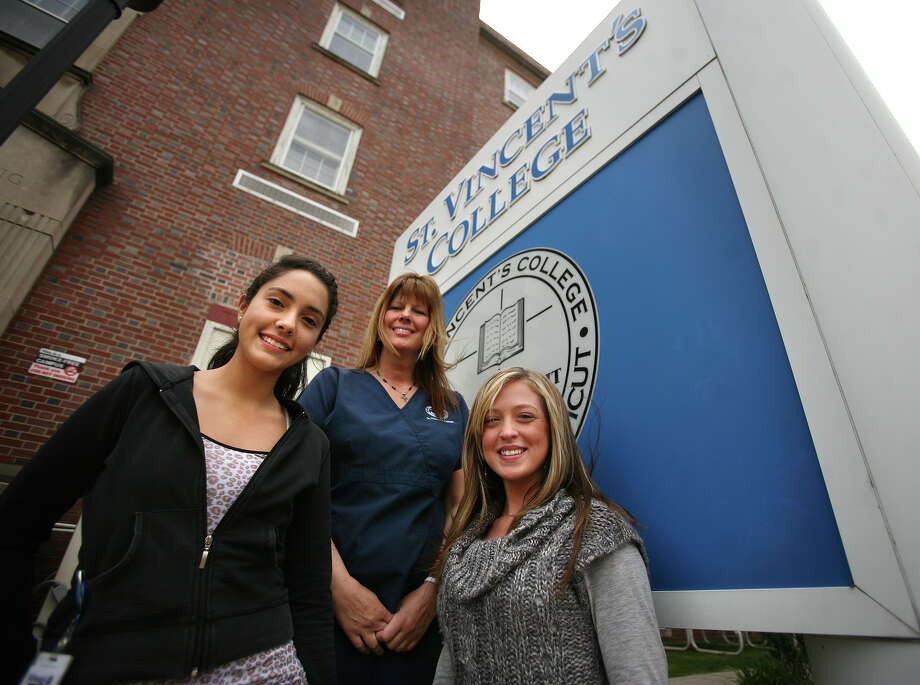 From left; Nursing students Jennifer Ricaurte of Seymour, Jeri Koch of Monroe, and Nichole Chouinard of Waterbury, at St. Vincent's College in Bridgeport on Wednesday, April 25, 2012. All three would like to participate in work study to help reduce their education costs. Photo: Brian A. Pounds / Connecticut Post
