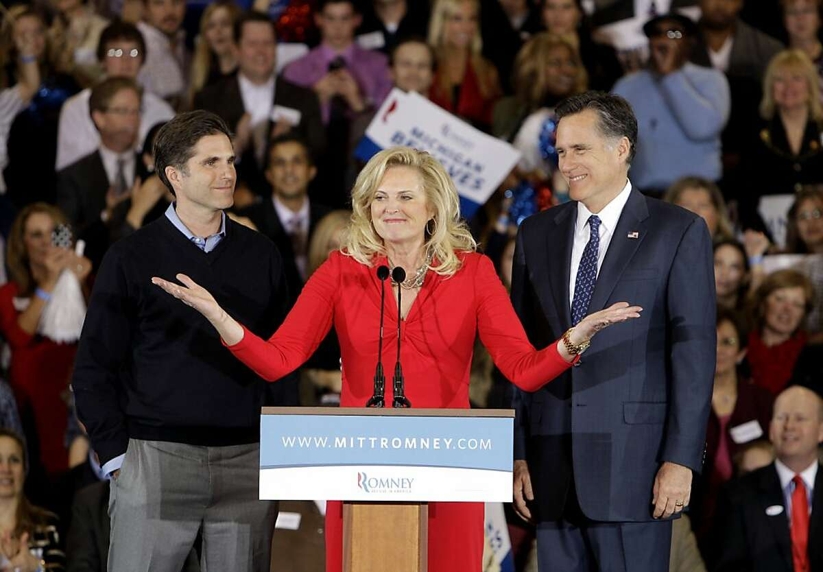 """In this Feb. 28, 2012 file photo, Ann Romney introduces Republican presidential candidate, former Massachusetts Gov. Mitt Romney and her son Tagg, in Novi, Mich. Mitt Romney is a grandfather again, and he has a surrogate to thank. Tagg Romney, the presumptive Republican presidential nominee's oldest son, announced Friday that that he has newborn twin sons. Tagg Romney tweeted """"big thanks"""" to the surrogate who gave birth to the twins, named David Mitt and William Ryder."""