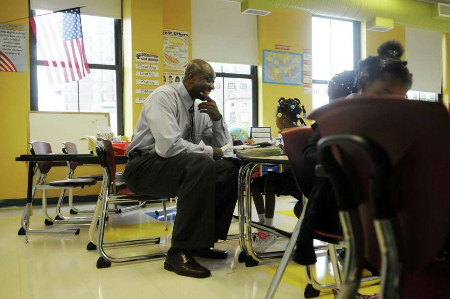 Anthony Clement talks with second-graders during the first day of school at Schuyler Achievement Academy elementary school last September.  (Paul Buckowski / Times Union archive) Photo: Paul Buckowski / 00014514A