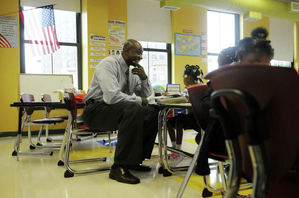 Anthony Clement talks with second-graders during the first day of school at Schuyler Achievement Academy elementary school last September. (Paul Buckowski / Times Union archive)