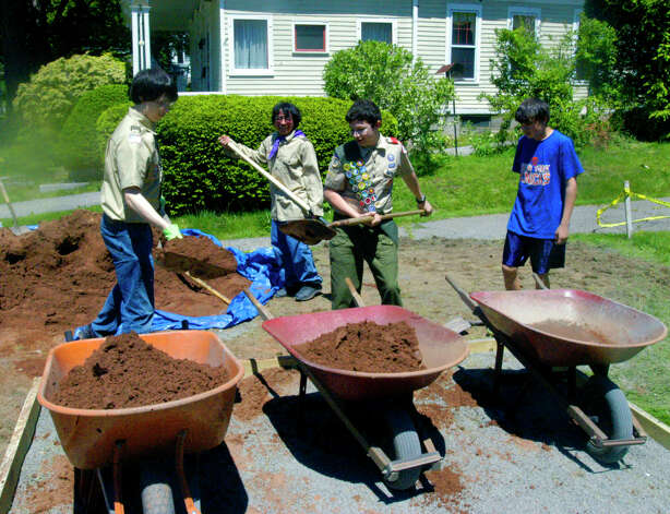 Thomas Vita, 15, third from the left, and fellow Boy Scouts work last weekend on the construction of a bocce court in front of the Richmond Citizen Center in New Milford. May 2012 Photo: Norm Cummings