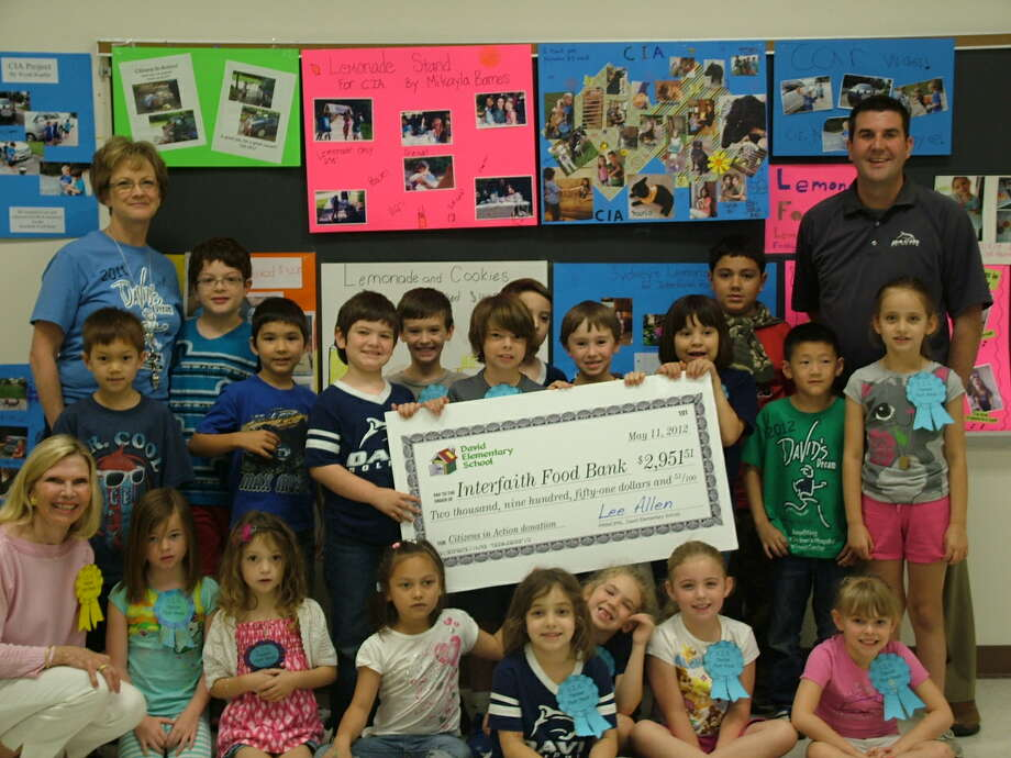 First-grade students from David Elementary, all members of the C.I.A. – Citizenship in Action—presented a check to Interfaith of The Woodlands' Food Pantry for $2,951.51.