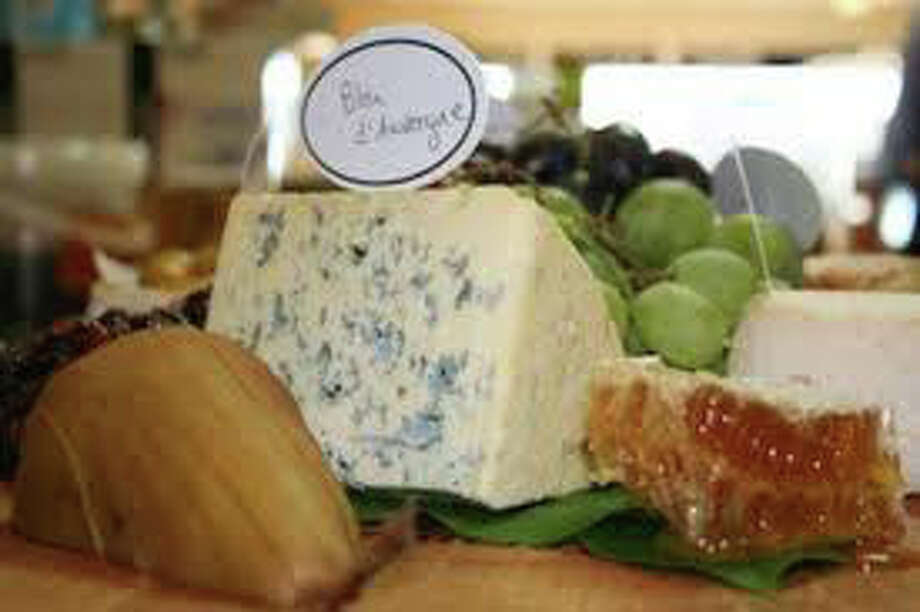 If you like things cheesy, you'll love the Fairfield Cheese Company's third anniversary party Saturday where you can meet a cow and enter a raffle for a $50 gift certificate. Photo: Contributed Photo / Fairfield Citizen