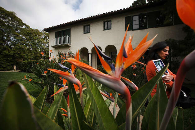 Bird of Paradise blooms frame a front yard view of the Winter House, built in 1925, an 'old world' Mediterranean estate designed by architect Ray J. Kieffer. The home in Beverly Hills, California, is on the market for the first time in 87 years. Photo: Brian Van Der Brug, MCT / Los Angeles Times