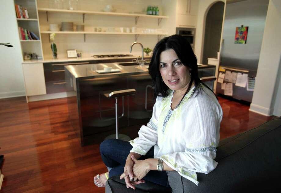 Mary Burchett in her renovated kitchen on April 25, 2012. Photo: Bob Owen, San Antonio Express-News / © 2012 San Antonio Express-News