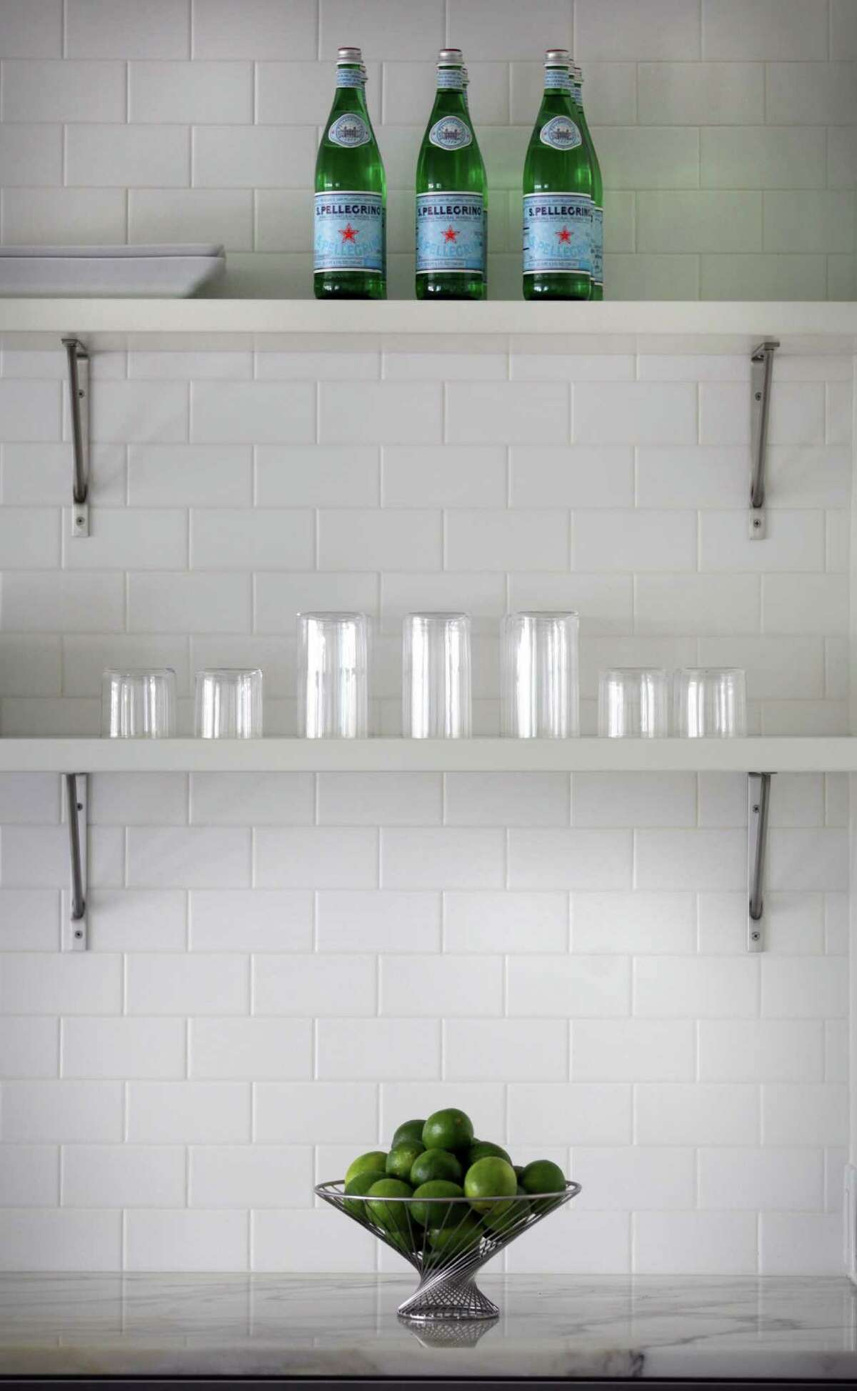 Clean and bright is the theme in the kitchen in Mary Burchett's home, Monday, April 25, 2012. Bob Owen