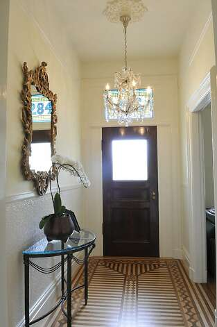 Inlaid parquet flooring stands out in the entryway. Photo: Garylee Hall