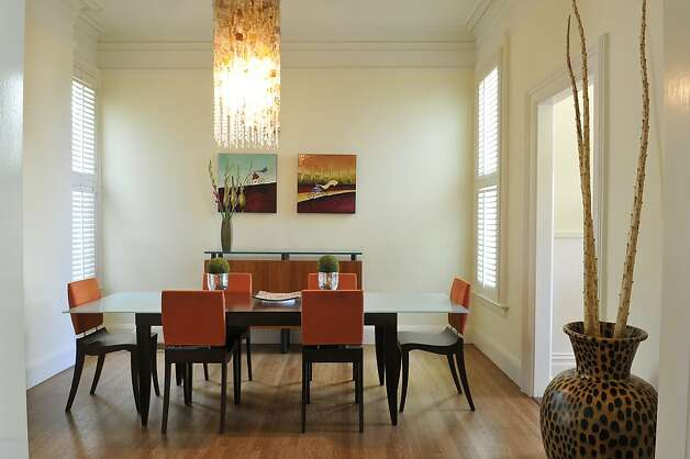 The family room flows in the dining room. Photo: Garylee Hall