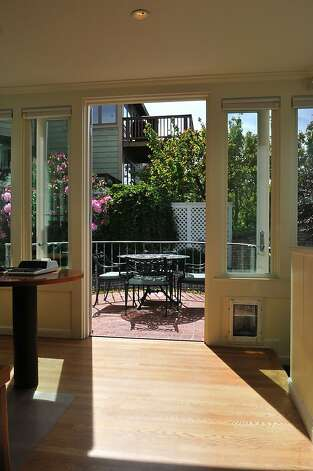 French doors from the kitchen lead to a patio area. Photo: Garylee Hall