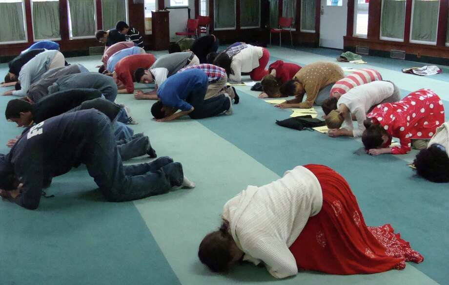 Fairfield Warde High School students visited a mosque in Bridgeport as part of an annual tour of houses of worship Tuesday and while they did not pray, they did follow the actions of those who had gathered for an afternoon prayer. Photo: Meg Barone / Fairfield Citizen freelance