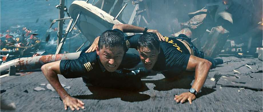 "(L to R) Nagata (TADANOBU ASANO) and Hopper (TAYLOR KITSCH) try to escape an attack in ""Battleship"", an epic-scale action-adventure that unfolds across the seas, in the skies and over land as our planet fights for survival against a superior force. Photo: Ilm, Universal Pictures"