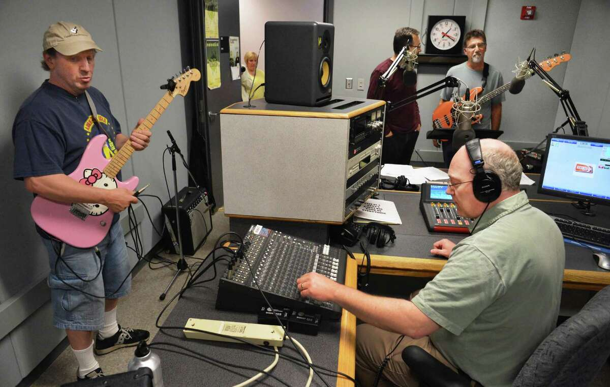 WEXT radio DJ and program director Chris Wienk, at controls, works with members of the The Tempered Blues in 2012. Wienk and WEXT both won awards at the Eddies Awards on Sunday, May 2, 2021. (John Carl D'Annibale/Times Union)