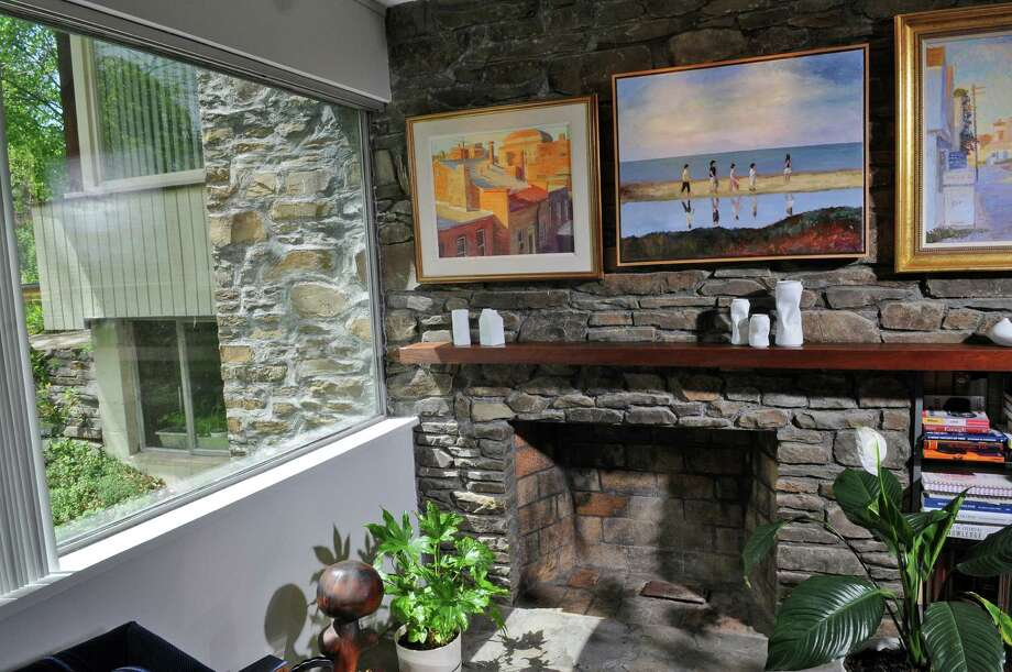 View of the fireplace in a Victor Civkin designed home on Thursday May 10, 2012 in Rotterdam, NY. The fireplace wall extends outside beyond the window at left. (Philip Kamrass / Times Union ) Photo: Philip Kamrass / 00017597A