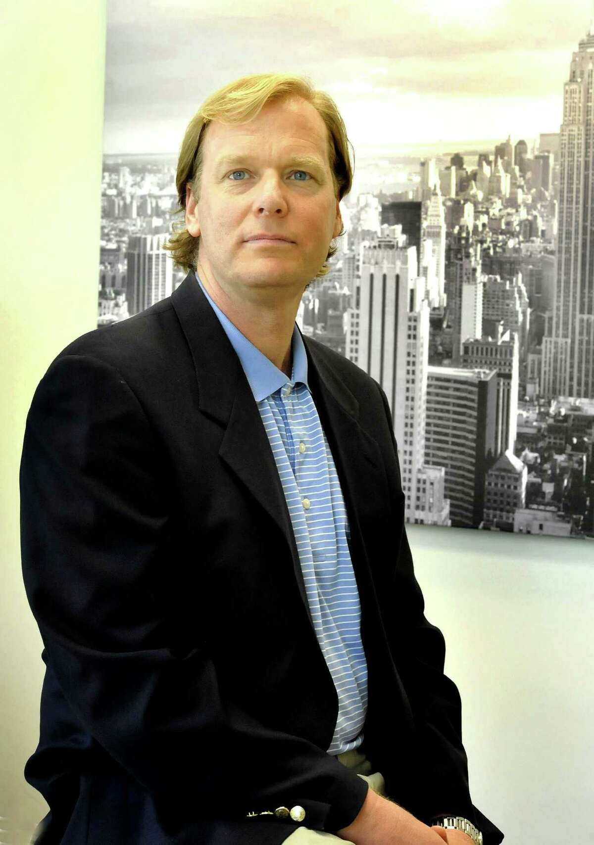 Scott Brunjes sits in his Danbury office of Mediassociates Friday, May 11, 2012.