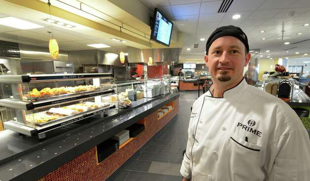 Executive Chef Ken Thompson oversees the food preparation at the Global Cafe in the Global Foundries complex in Malta, N.Y. May 14, 2012. (Skip Dickstein / Times Union) Photo: SKIP DICKSTEIN / 2012
