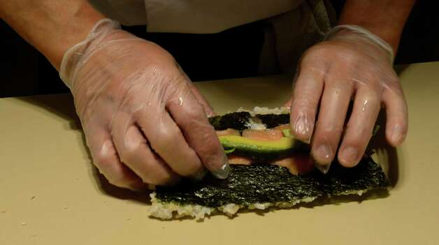 The hands of Sushi Chef Saso at the Global Cafe in the Global Foundries complex in Malta, N.Y. May 14, 2012. (Skip Dickstein / Times Union) Photo: SKIP DICKSTEIN / 2012
