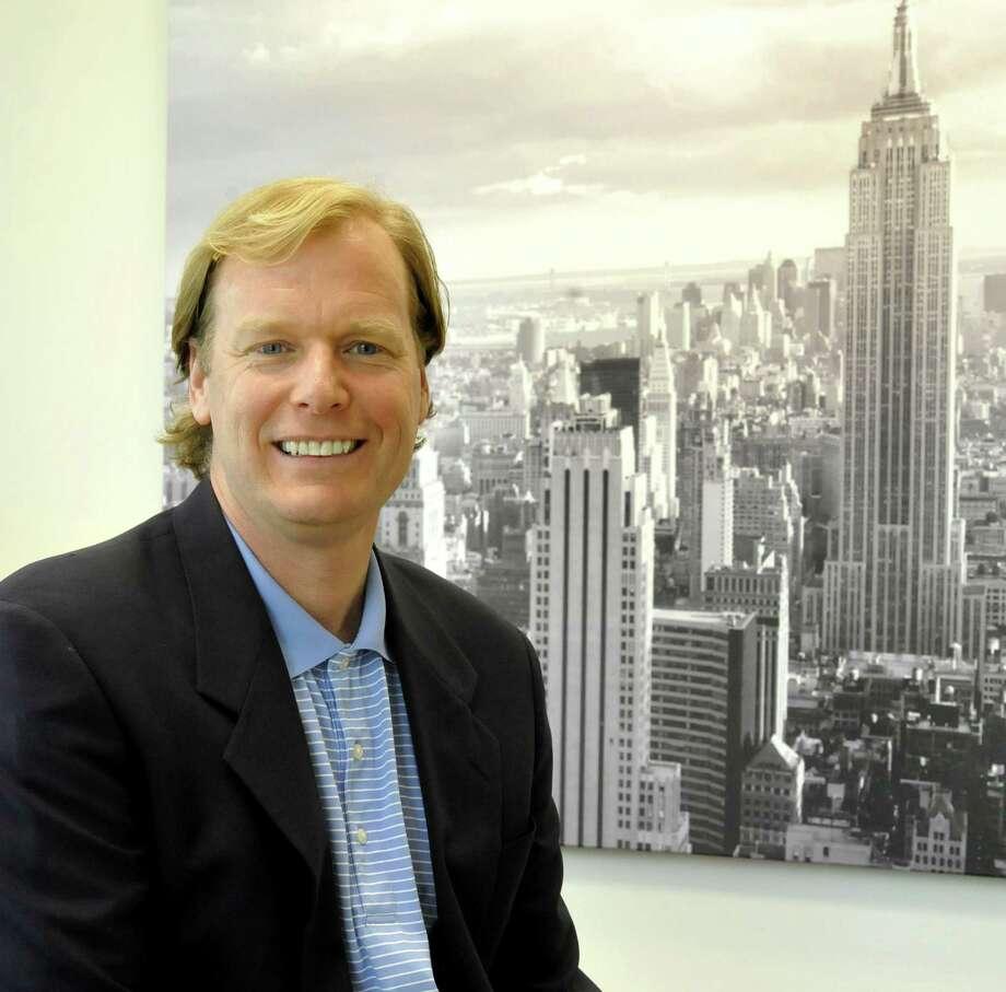 Scott Brunjes sits in his Danbury office of Mediassociates,  Friday, May 11, 2012. Photo: Michael Duffy
