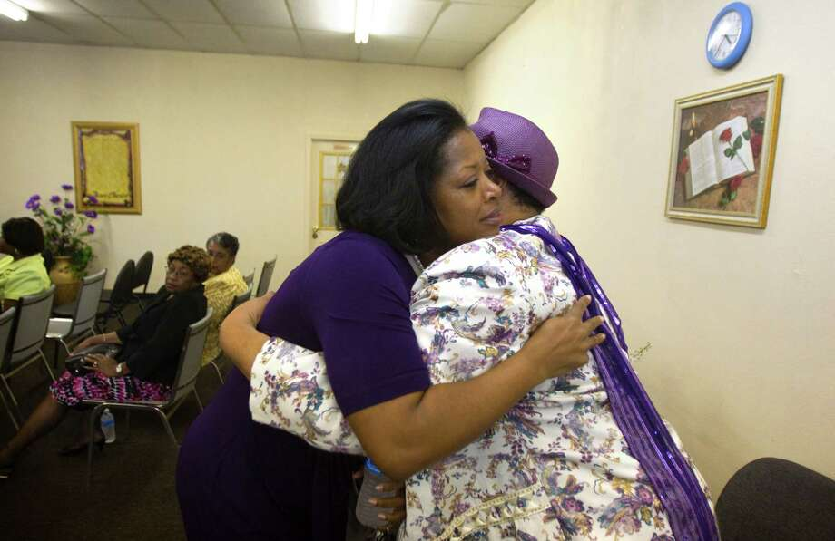 Vascola Stoney, left, hugs Rosie Nelson, right, after Stoney spoke at Thy Kingdom Come Outreach Ministry Sunday, March 25, 2012, in Houston. (Cody Duty / Houston Chronicle) Photo: Cody Duty / © 2011 Houston Chronicle