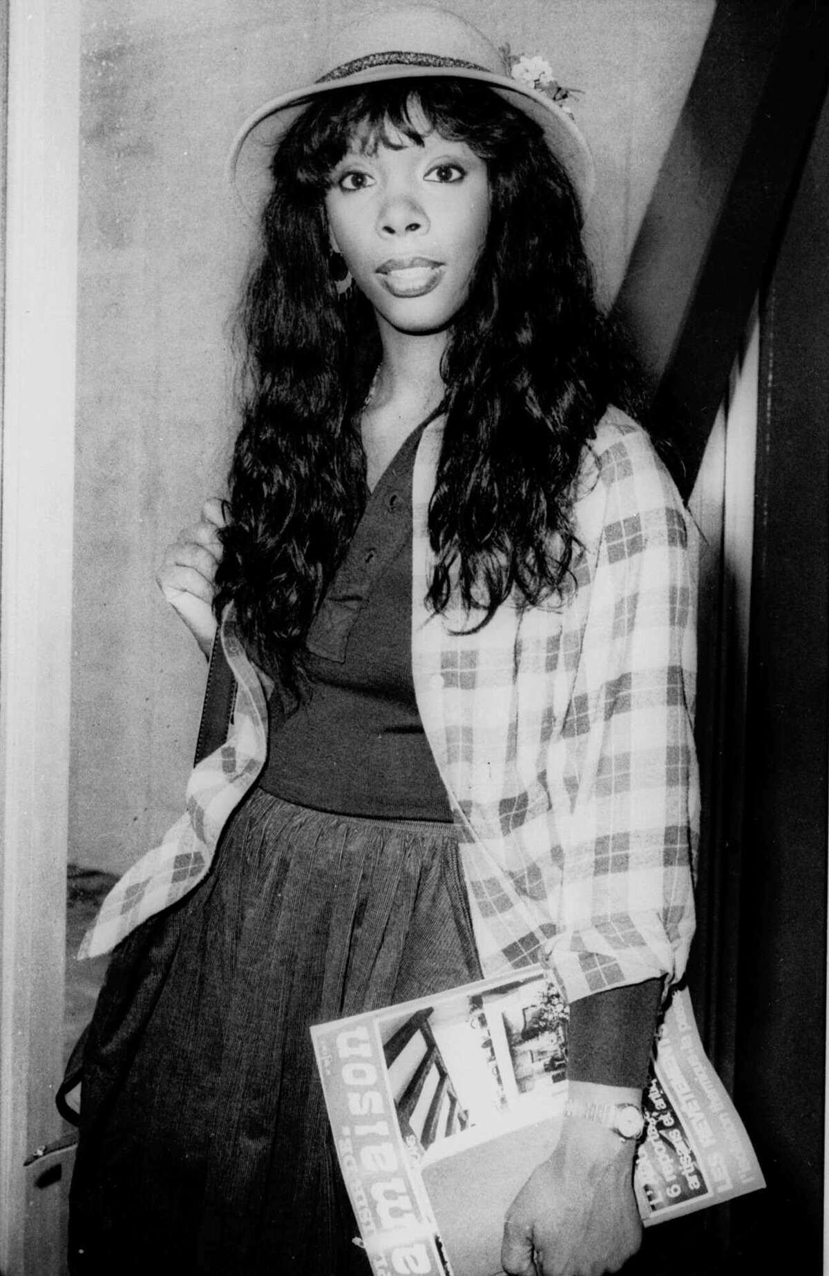 FILE - In this Oct. 21, 1977 file photo, Donna Summer, 27, arrives at Heathrow Airport from Paris. Summer, the Queen of Disco who ruled the dance floors with anthems like