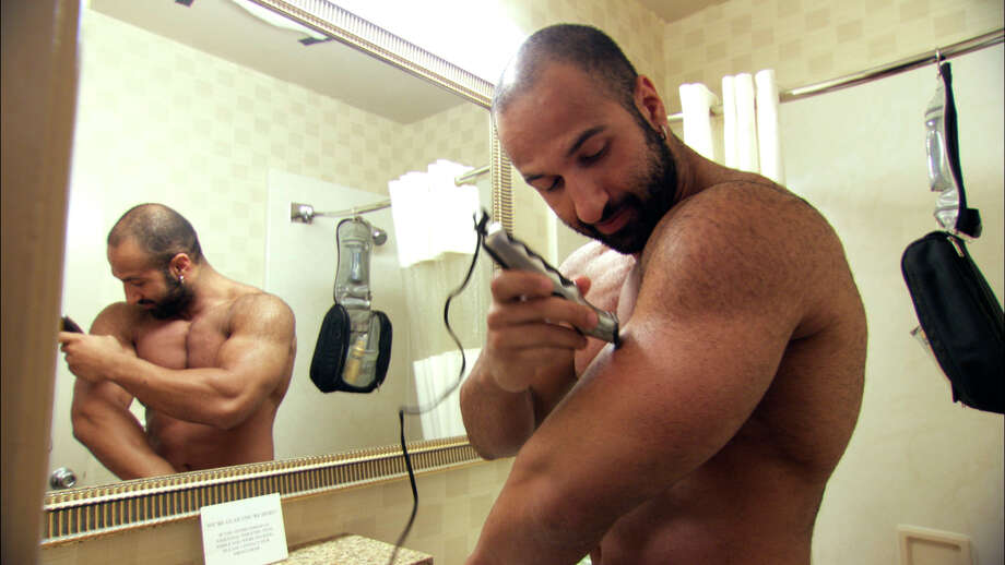 "Wrestler Shawn Daivari spends much of his time outside the ring working out, tanning and shaving from head to toe in ""Mansome."" Photo: Paladin Films"