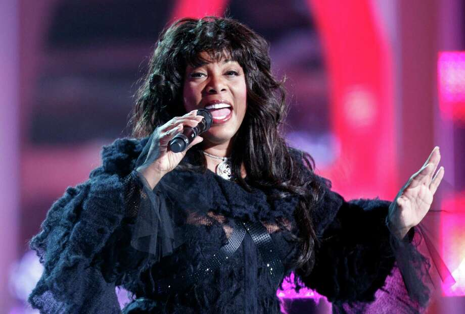 (FILES) In this file picture taken on December 11, 2009 US singer Donna Summer performs on stage during the Nobel Peace Prize Concert in Oslo Spektrum.   Disco legend Donna Summer died in Florida aged 63 on May 17, 2012 after a battle against cancer.  AFP PHOTO / Bjorn Sigurdson, Scanpix      NORWAY OUTSIGURDSON, BJORN/AFP/GettyImages Photo: SIGURDSON, BJORN / AFP