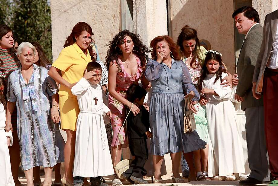 "Center to Right: Nadine Labaki as Amale, Antoinette Noufaily as Saydeh and Caroline Labaki as Aida in, ""Where Do We Go Now?"" Photo: Rudy Bou Chebel, Sony Pictures Classics"