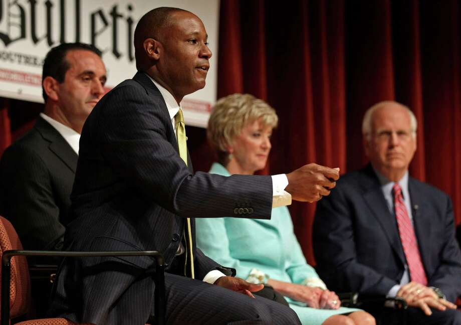 Brian K. Hill, left, gestures during a debate for the seat being vacated by U.S Sen. Joe Lieberman, I-Conn., in Norwich, Conn., Thursday, April 19, 2012. From left are Peter Lumaj, Hill, Linda McMahon and Christopher Shays. (AP Photo/Charles Krupa) Photo: Charles Krupa, Associated Press / AP
