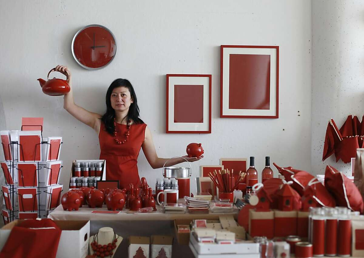 Part of an art installation that will be on display at Fort Point for the anniversary of the Golden Gate Bridge, San Francisco artist Stephanie Syjuco shows off a mock souvenir shop in which everything is the color of the bridge on April 27, 2012 in San Francisco, Calif.