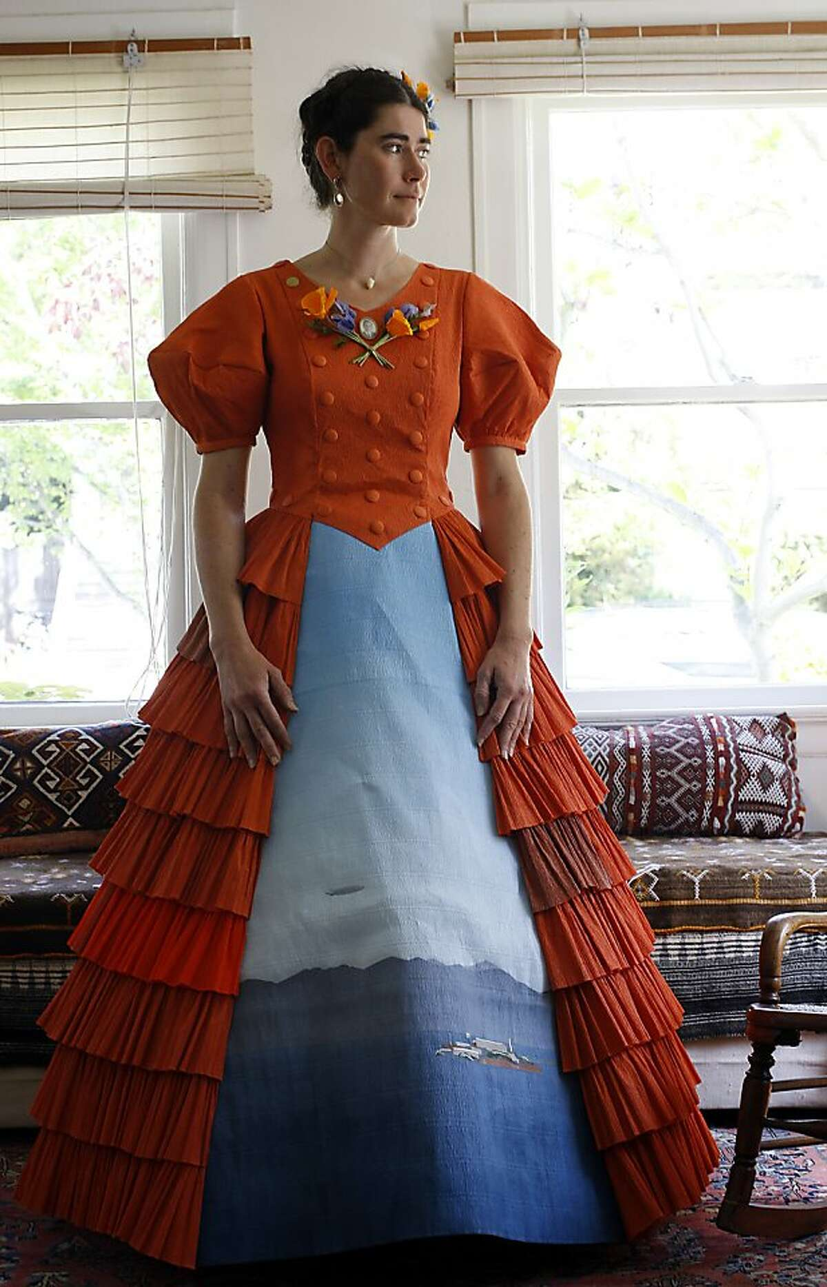 Artist Anandamayi Arnold works on 7 crape paper dresses as one of 17 artists in