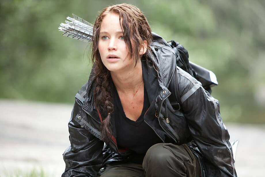 "In this image released by Lionsgate, Jennifer Lawrence portrays Katniss Everdeen in a scene from ""The Hunger Games."" (AP Photo/Lionsgate, Murray Close) Photo: Murray Close, Associated Press"