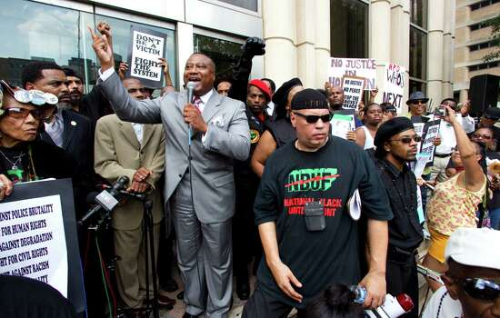 Quanell X speaks on the steps of the Harris County Criminal Justice Center during a protest Thursday, May 17, 2012, in Houston. The demonstrators marched in response to the not guilty verdict handed down by a jury Wednesday in the case against former Houston Police officer Andrew Blomberg. Blomberg had been accused of official oppression for his role in the 2010 beating of Chad Holley, which was caught on videotape. Photo: Brett Coomer, Houston Chronicle / © 2012 Houston Chronicle