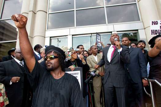 Bishop James Dixon, right, speaks on the steps of the Harris County Criminal Justice Center during a protest Thursday, May 17, 2012, in Houston. The demonstrators marched in response to the not guilty verdict handed down by a jury Wednesday in the case against former Houston Police officer Andrew Blomberg. Blomberg had been accused of official oppression for his role in the 2010 beating of Chad Holley, which was caught on videotape. Photo: Brett Coomer, Houston Chronicle / © 2012 Houston Chronicle