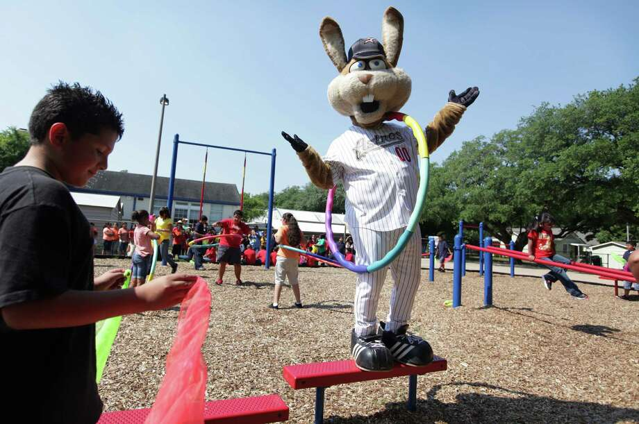 Astros' Junction Jack cheers after climbing a couple of steps during the   launch of the new Project Fit America fitness playground at Eugene Field Elementary School on Thursday, May 17, 2012, in Houston. Photo: Mayra Beltran, Houston Chronicle / Houston Chronicle