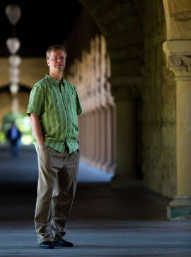 Linked-In co-founder Konstantin Guericke stands in a hall at Stanford.