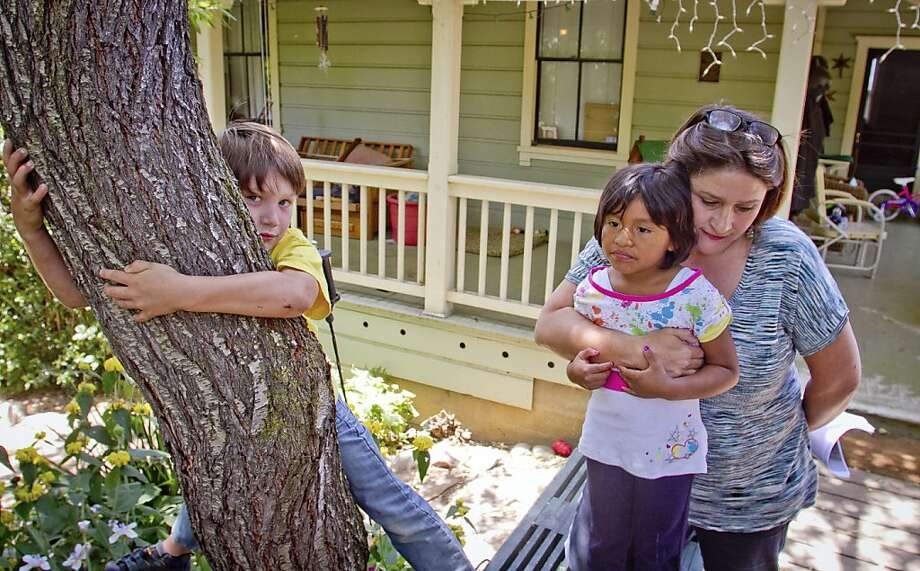 Erika Gregory with her children, Jack and Lucy Mollner at their home in Vallejo, Calif., on Thursday, May 17th, 2012. Their dog, Belle, was shot by a police officer when the officer came to their home to take a fraud report. Photo: John Storey, Special To The Chronicle