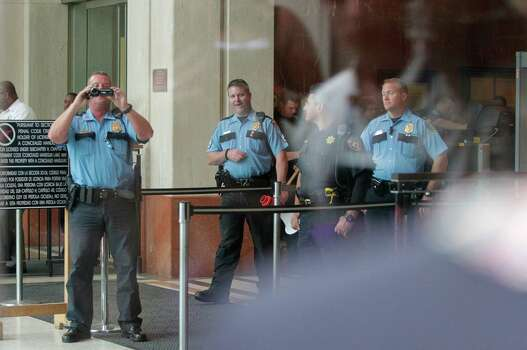 HPD officers videotape protesters outside the Harris County Criminal Courthouse. Photo: Mayra Beltran, Houston Chronicle / Houston Chronicle