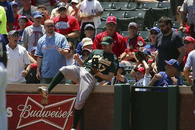 ARLINGTON, TX - MAY 17: Adam Rosales #17 of the Oakland Athletics catches a pop fly hit by Ian Kinsler #5 of the Texas Rangers at Rangers Ballpark in Arlington on May 17, 2012 in Arlington, Texas. (Photo by Rick Yeatts/Getty Images) Photo: Rick Yeatts, Getty Images