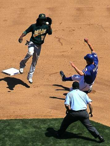 ARLINGTON, TX - MAY 17: Jemile Weeks #19 of the Oakland Athletics makes the catch but misses the tag on David Murphy #7 of the Texas Rangers at Rangers Ballpark in Arlington on May 17, 2012 in Arlington, Texas. (Photo by Rick Yeatts/Getty Images) Photo: Rick Yeatts, Getty Images