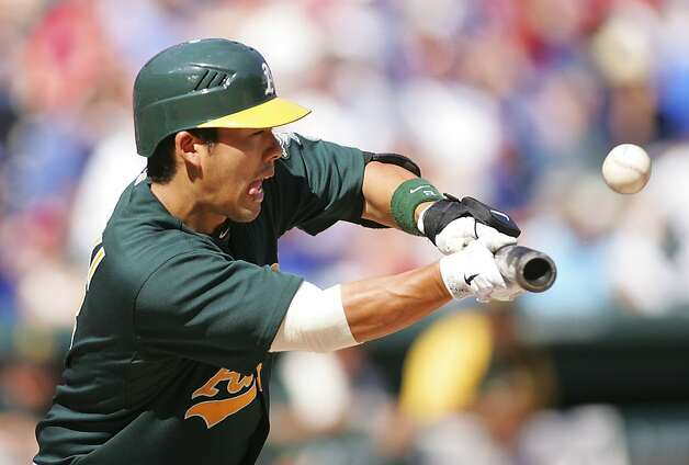 ARLINGTON, TX - MAY 17: Kurt Suzuki #8 of the Oakland Athletics bunts and pops out to Mike Adams #37 of the Texas Rangers at Rangers Ballpark in Arlington on May 17, 2012 in Arlington, Texas. (Photo by Rick Yeatts/Getty Images) Photo: Rick Yeatts, Getty Images