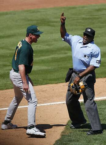 ARLINGTON, TX - MAY 17: Home plate umpire umpire Laz Diaz #63 ejects Bob Melvin #6 of the Oakland Athletics in the sixth inning at Rangers Ballpark in Arlington on May 17, 2012 in Arlington, Texas. (Photo by Rick Yeatts/Getty Images) Photo: Rick Yeatts, Getty Images