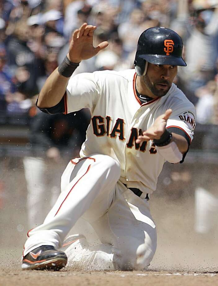 San Francisco Giants' Angel Pagan celebrates after scoring against the St. Louis Cardinals during the sixth inning of a baseball game, Thursday, May 17, 2012, in San Francisco. Pagan scored on a sacrifice fly by Emmanuel Burriss. (AP Photo/Ben Margot) Photo: Ben Margot, Associated Press