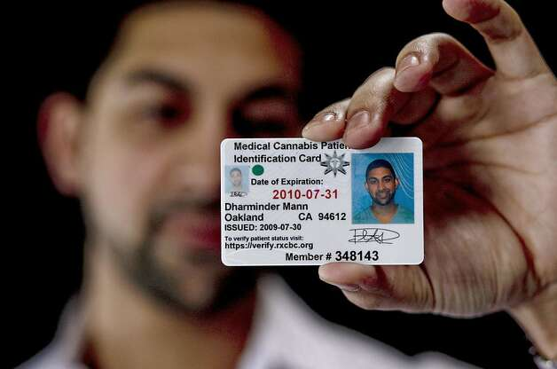 Dhar Mann displays his Medical Cannabis Card on Wednesday January 27, 2010. He had planned on opening a one-stop shop for medical marijuana growth and cultivation. Photo: Michael Macor, The Chronicle