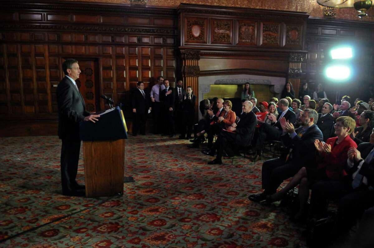 Lieutenant Governor Robert Duffy, left, speaks about Governor Andrew Cuomo's announcement that the state will end finger imaging requirements for food stamp recipients, in the Red Room at the Capitol on Thursday May 17, 2012 in Albany, NY. (Philip Kamrass / Times Union )