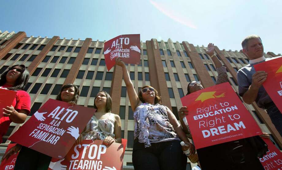 Attendees from left Maria Mendez, Carol Mendoza, Yvonne Mendoza, Martina Grifaldo, Cherye Jefferson and pastor Brad Fuerst, show their support during a DREAM Act rally at the University of Houston-Downtown, Thursday, May 17, 2012, in Houston. The event aimed to encourage individuals to show their support for the DREAM Act, Development, Relief, and Education for Alien Minors, which would allow undocumented students an eventual path to citizenship. (Cody Duty / Houston Chronicle) Photo: Cody Duty / © 2011 Houston Chronicle